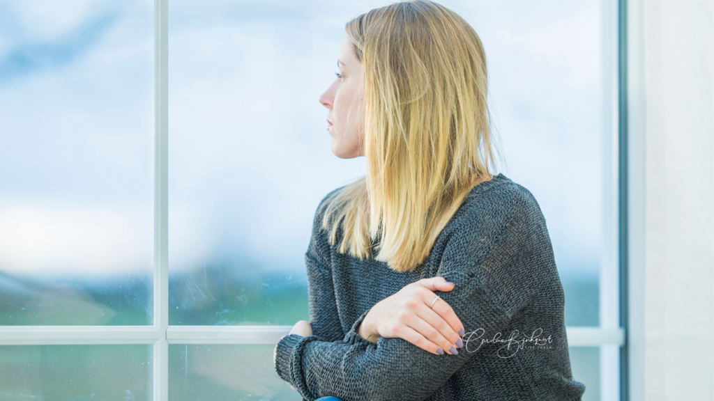 woman looking into distance deep in thought